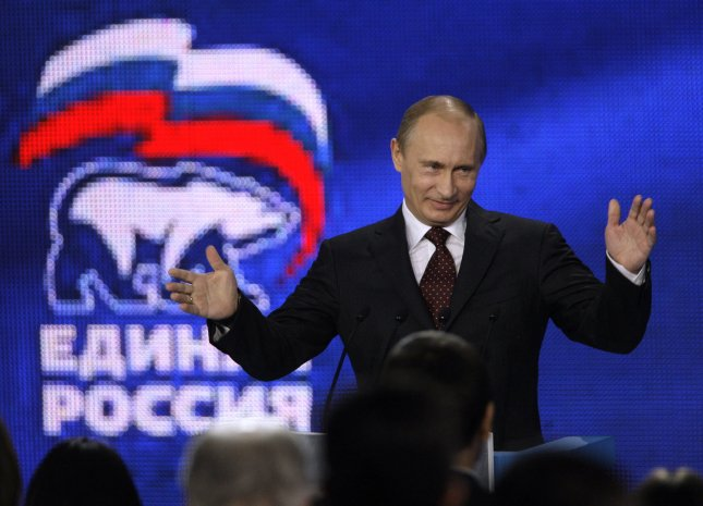 Russian Prime Minister Vladimir Putin greets the audience at the United Russia party's congress in St. Petersburg on November 21, 2009. UPI/Anatoli Zhdanov