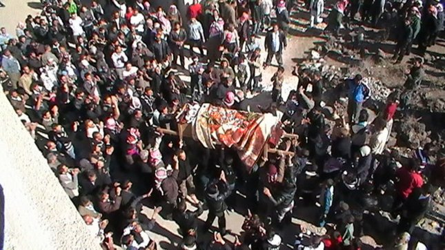 Syrian mourners carry the body of anti-regime protester shot dead by security forces loyal to Syrian President Bashar al-Assad the previous day during a group funeral procession in the town of Nawa, Darra city, Syria, in November 11, 2011 . Syria freed more than 1,000 prisoners in an apparent last-ditch bid to placate Arab leaders as Turkey and the United Nations warned President Bashar al-Assad to stop killing his own people. UPI