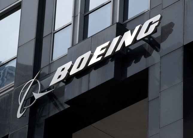 The Boeing logo hangs from the Boeing Building, international headquarters for the Boeing Company, in Chicago on March 31, 2011. Boeing moved its corporate headquarters to Chicago from Seattle in 2001. UPI/Brian Kersey