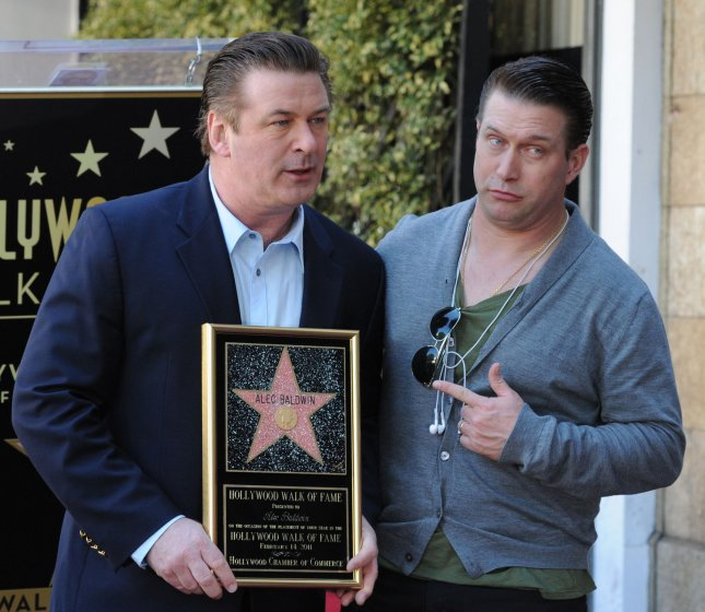 Actor Alec Baldwin holds a replica plaques as he poses with his brother, actor Stephen Baldwin during an unveiling ceremony honoring him with the 2,433rd star on the Hollywood Walk of Fame in Los Angeles on February 14, 2011. UPI/Jim Ruymen