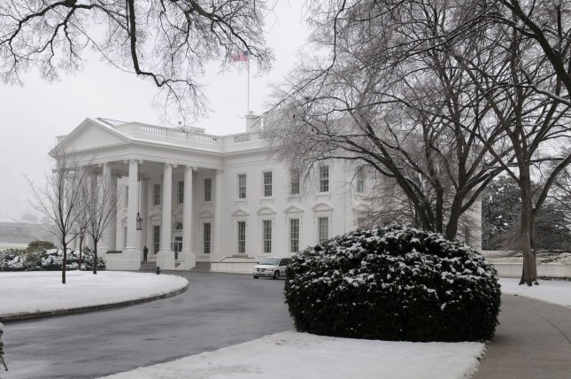 The north lawn of the White House is covered in a layer of snow and ice after a winter storm hit the Washington metro area, in Washington on January 28, 2009. (UPI Photo/Kevin Dietsch)