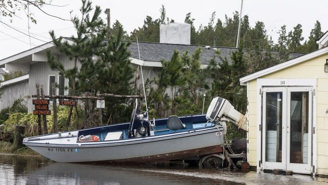 A power boat is washed up on the backyard of a house in Tuckerton, New Jersey October 30, 2012 after Hurricane Sandy made landfall late October 29, 2012. The Category One storm produced winds up to 90 miles an hour in this area of New Jersey. UPI/John Anderson