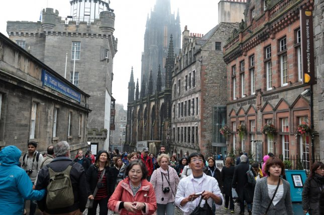 Tourists walk down the Royal Mile in Edinburgh the day after Scotland voted to remain part of the United Kingdom with a No vote winning the Referendum fifty-five percent to forty-five percent, on September 19, 2014. UPI/Hugo Philpott