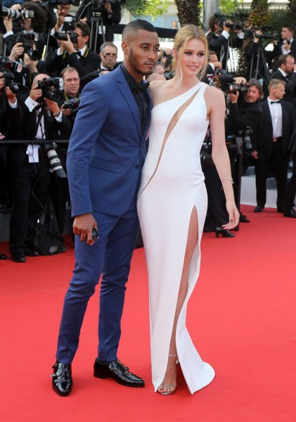 Doutzen Kroes (R) and Sunnery James at the 68th annual Cannes Film Festival on May 13, 2015. Photo by David Silpa/UPI