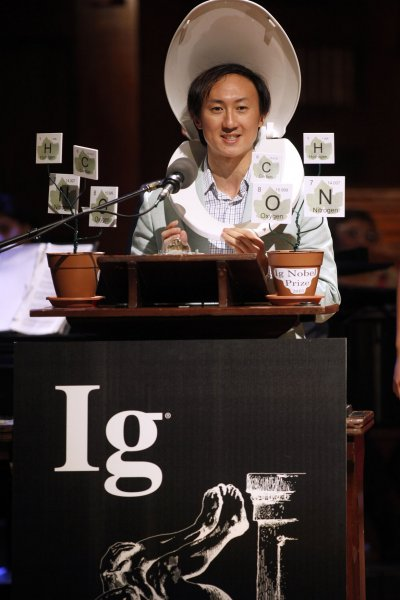 David Hu of Georgia Tech, (C) accepts the 2015 Ig Nobel Prizes in Physics for testing the biological principle that nearly all mammals empty their bladders in about 21 seconds (plus or minus 3 seconds) at the awards ceremony at Harvard University in Cambridge, Massachusetts on September 17, 2015. The prizes which are awarded by the Annals of Improbable Research are intended to celebrate the unusual, honor the imaginative and spur people's interest in science, medicine, and technology. Photo by Matthew Healey/ UPI