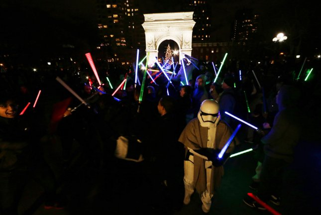 Star Wars movie fans participate in the annual Lightsaber Battle at Washington Square Park in New York City on December 18, 2015. Photo by John Angelillo/UPI