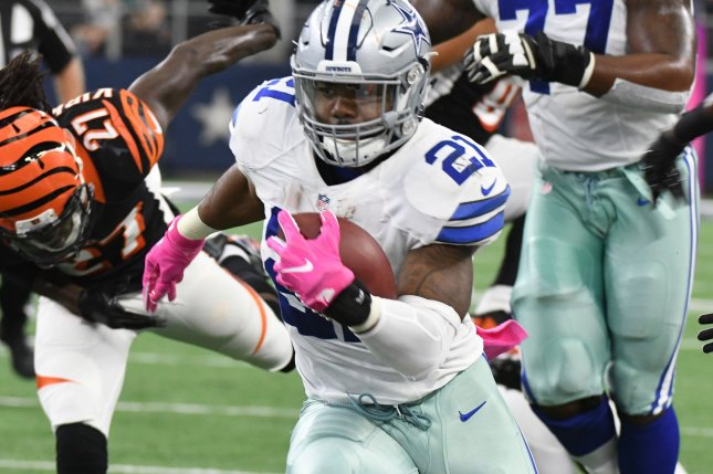 Dallas Cowboys Ezekiel Elliott rushes against the Cincinnati Bengals during the first half at AT&T Stadium in Arlington, Texas on October 6, 2016. First-round pick Elliott leads the league with 703 rushing yards. Ian Halperin/UPI