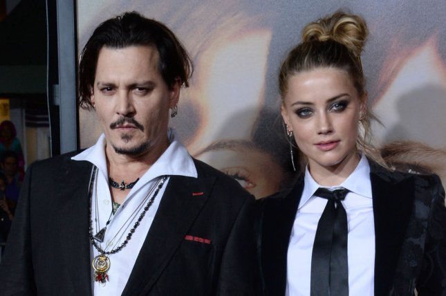 Amber Heard (R) and Johnny Depp at the Los Angeles premiere of The Danish Girl on November 21, 2015. File Photo by Jim Ruymen/UPI