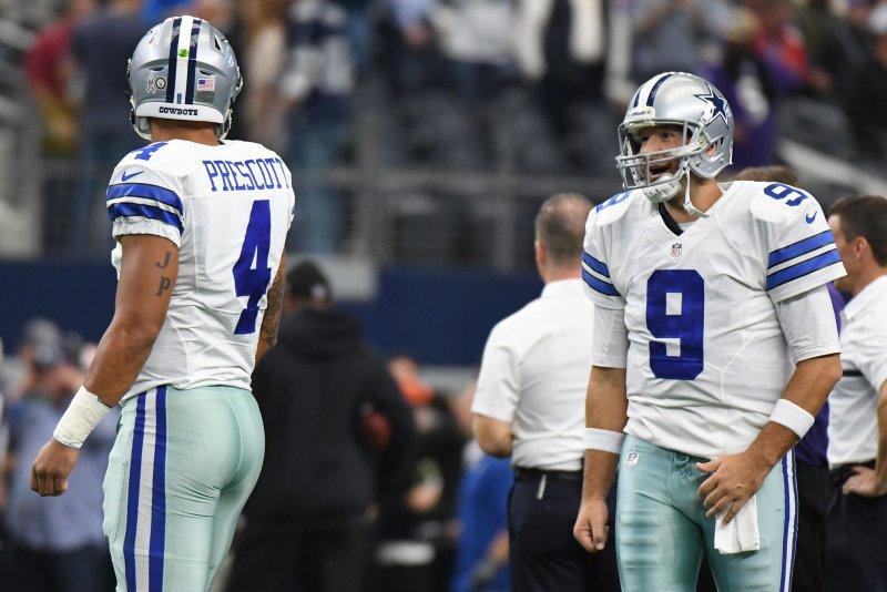 Dallas Cowboys quarterback Tony Romo, right, talks to his former backup Dak Prescott as they warm up prior to facing the Baltimore Ravens on November 20, 2016 at AT&T Stadium in Arlington, Texas. Prescott has started in place of Romo all season.. Ian Halperin/UPI