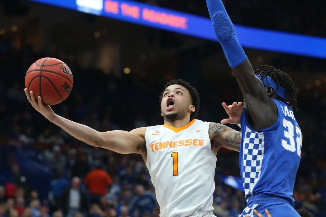 Tennessee's Lamonte Turner gets past the Kentucky's Wenyen Gabriel for two points in the first half of the SEC Championship game on March 11 at the Scottrade Center in St. Louis, Mo. Photo by BIll Greenblatt/UPI