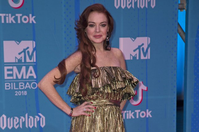 Lindsay Lohan said she's learned since live-streaming a video of herself accosting a family she believed to be Syrian refugees. File Photo by Sven Hoogerhuis/UPI