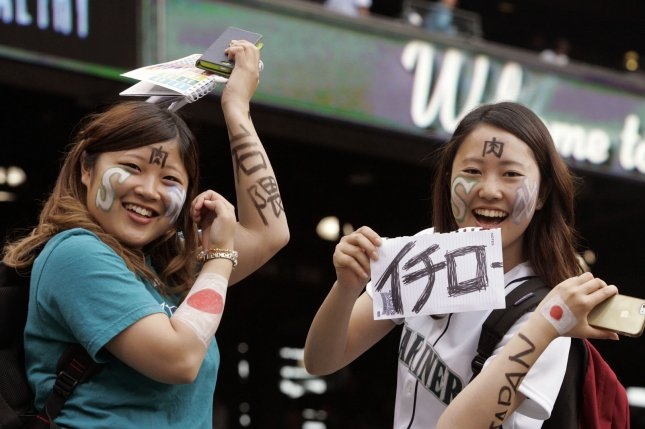 Two baseball fans from Japan mug for the camera before the New York Yankees vs. Seattle Mariners game. File photo by Jim Bryant/UPI