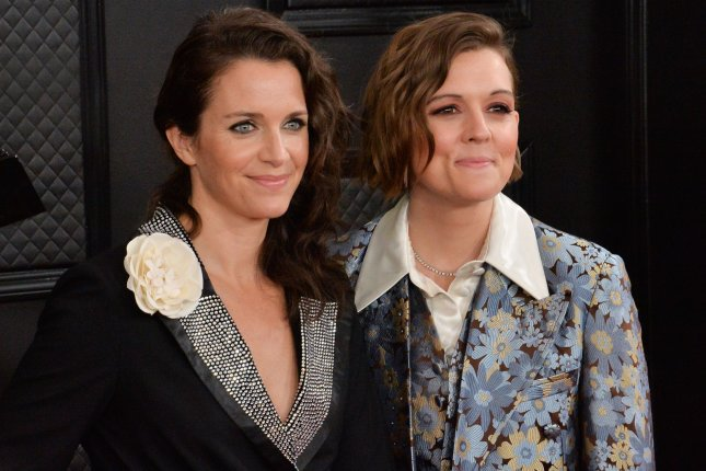 Brandi Carlile (R) and her wife Catherine Shepherd arrive for the 62nd annual Grammy Awards on January 26. Carlile has been nominated in multiple categories for this year's Americana Honors & Awards. File Photo by Jim Ruymen/UPI