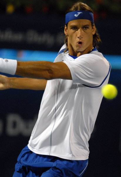 Spain's Feliciano Lopez returns the ball duing the Dubai Tennis Championships March 8, 2008. (UPI Photo/Norbert Schiller)