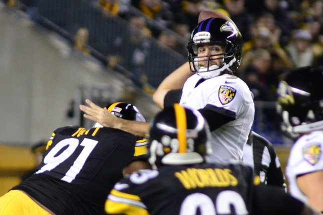 f33b66c68 Baltimore Ravens quarterback Joe Flacco (5) steps back to pass in the first  quarter and passes incomplete with pressure from Pittsburgh Steelers  defensive ...