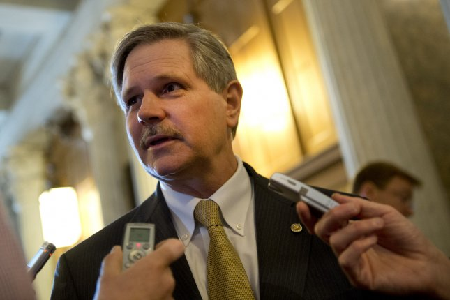 Sen. John Hoeven (R-ND) talks to reporters as walks to the Senate Chambers at the US Capitol in Washington, D.C. UPI/Kevin Dietsch