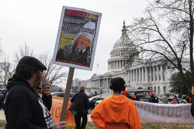 Protesters rally at the U.S. Capitol in Washington, D.C., on January 31 during the Senate impeachment trial of President Donald Trump.  Photo by Pat Benic/UPI