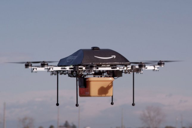 This undated Amazon.com image shows a prototype of their Prime Air delivery drone which Amazon hopes to use to deliver packages to customers in as little as 30 minute. Amazon CEO Jeff Bezos has said putting the Prime Air feature into commercial use will take some number of years as Amazon develops technology and waits for the Federal Aviation Administration to create guidelines. On May 12, 2015, two U.S. senators introduced a bill that offers basic guidelines for commercial drone usage during the interim period in which the FAA finalizes its regulations. Photo by Amazon