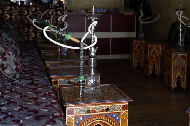 A hookah bar waits for its first customers of the day in New York City in April 2014. Smoking hookah has become increasingly popular with teenagers and college students who find it relaxing and believe it to be less harmful to health than cigarettes or other tobacco products. File photo by John Angelillo/UPI
