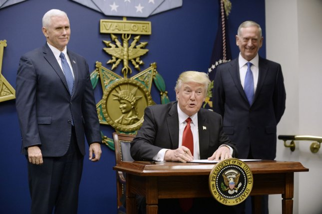 The Pentagon is reportedly considering sending ground troops to Syria in an effort to speed to fight against the Islamic State, an idea U.S. President Donald Trump endorsed on the campaign trail last year and Defense Secretary James Mattis told Congress during his confirmation hearing that he may be open to. Pictured, Trump, Mattis and Vice President Mike Pence as the president signs an executive order authorizing more strict vetting of refugees coming to the United States. Pool photo by Olivier Douliery/UPI