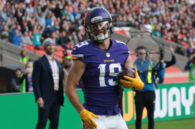 Minnesota Vikings wide receiver Adam Thielen celebrates a touchdown in the  NFL International Series game against the Cleveland Browns at Twickenham  Stadium eedcf1696