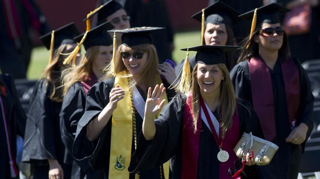 Graduates wave as they arrive for the 2012 Virginia Tech graduation ceremony at Lane Stadium on the campus of Virginia Tech University in Blacksburg, Virginia on May 11, 2012. UPI/Kevin Dietsch