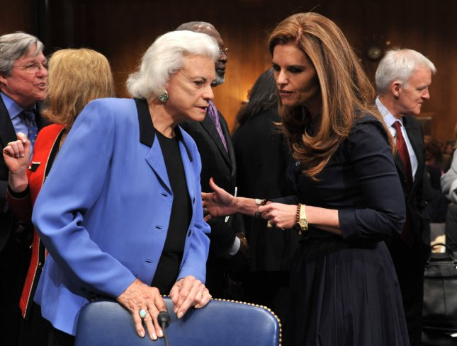 11 new Alzheimer's genes may increase odds of finding drug therapy. Maria Shriver (R) greets former Supreme Court Associate Justice Sandra Day O'Connor before testifying before a Special Senate Aging Committee hearing on Alzheimer's in Washington. (UPI Photo/Kevin Dietsch)