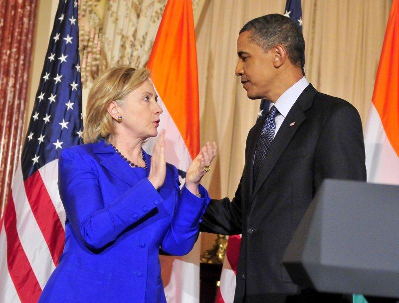 United States President Barack Obama, right, and U.S. Secretary of State Hillary Rodham Clinton, left, UPI/Ron Sachs/Pool