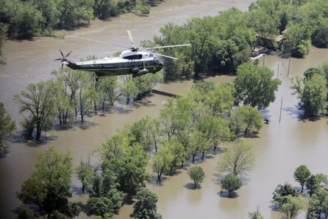 Memories of massive flooding in Iowa in 2008 -- Marine One is pictured above during President George W. Bush's visit to the area -- have moved residents of eastern Iowa to start preparing for what could be devastating floods near Cedar Rapids. UPI file photo by Liz Martin/The Gazette/Pool)