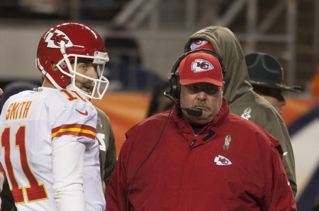 Kansas City Chiefs quarterback Alex Smith (C) and head coach Andy Reid wait on the officials for a review on a touchdown pass in the fourth quarter against the Denver Broncos at Sports Authority Field at Mile High. File photo by Gary C. Caskey/UPI