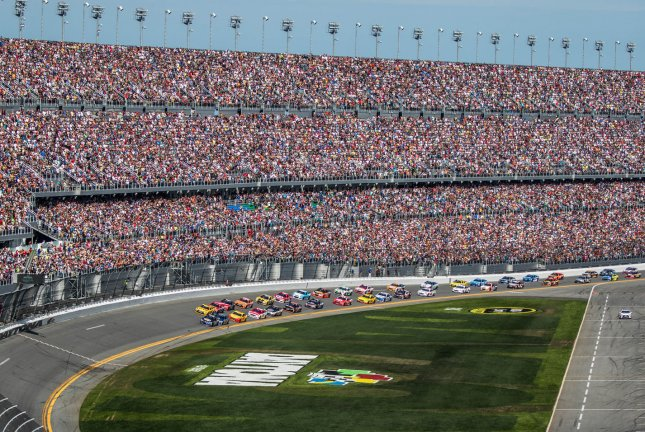 The front row of Chase Elliott (blue car) and Matt Kenseth lead the field of 40 cars to the start of the Daytona 500 at Daytona International Speedway on February 21, 2016 in Daytona, Florida. File photo by Edwin Locke/UPI