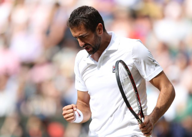 Marin Cilic celebrates a point in his match against Sam Querrey in the men's semifinals of the 2017 Wimbledon championships on Friday. Photo by Hugo Philpott/UPI
