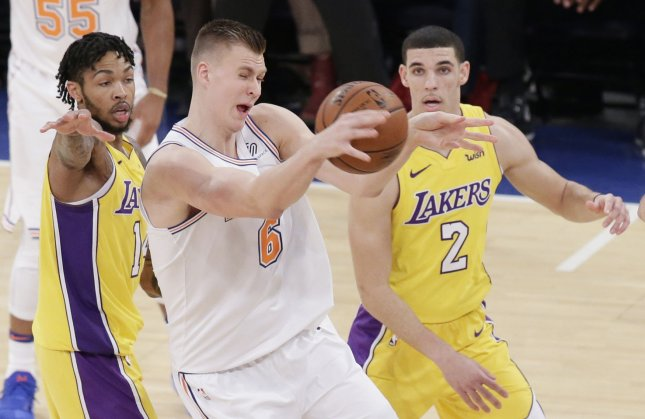 New York Knicks forward Kristaps Porzingis goes after the ball in a game against the Los Angeles Lakers earlier this week. Photo by John Angelillo/UPI