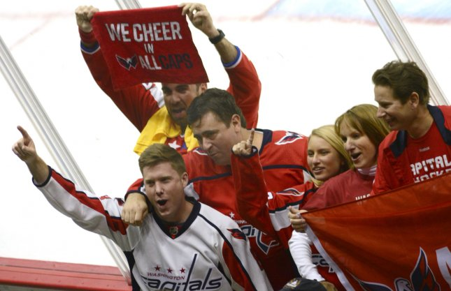Washington Capitals fans celebrate a win over in the Stanley Cup Playoffs. The Capitals lead the Las Vegas Golden Knights, 3-1, in the Stanley Cup Finals. Photo by Archie Carpenter/UPI