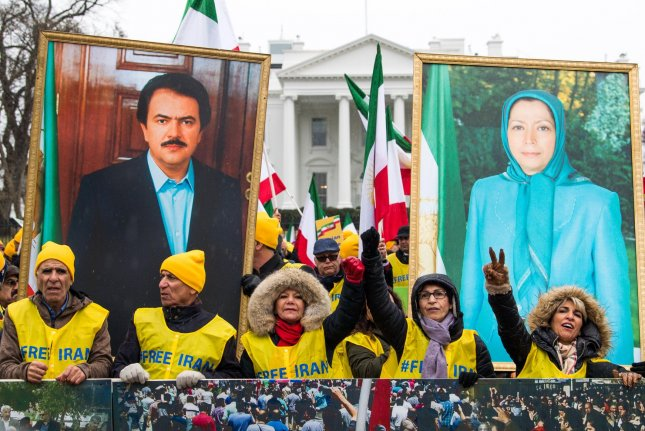 Demonstrators hold portraits of Iranian politicians Massoud Rajavii and his wife, Maryam Rajavi, at a rally held by the Organization of Iranian-American Communities in support of a regime change in Iran, in Washington, D.C. on March 8. File Photo by Kevin Dietsch/UPI
