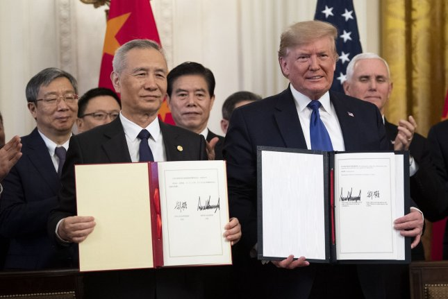 U.S. President Donald Trump and Chinese Vice Premier Liu He hold the phase one trade deal between the United States and China they signed Wednesday in the East Room of the White House. Photo by Alex Wroblewski/UPI