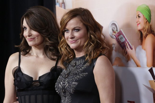 Tina Fey (L) and Amy Poehler will host the 2021 Golden Globe Awards in February. File Photo by John Angelillo/UPI