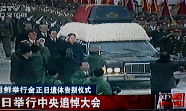 China's state television shows footage of Kim Jong-un walking next to a hearse carrying his father North Korean leader Kim Jong-Il's body through the streets of Pyongyang during a state funeral December 28, 2011. Jong Il's body will lie in state with his father. UPI/Stephen Shaver