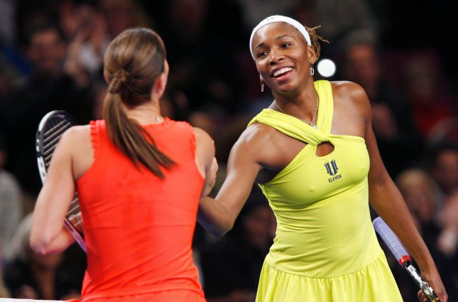 Venus Williams shakes hands with Jelena Jankovic after defeating her in a one set semifinal match in the BNP Paribas Showdown for the Billie Jean King Cup at Madison Square Garden in New York City on March 2, 2009. (UPI Photo/John Angelillo)