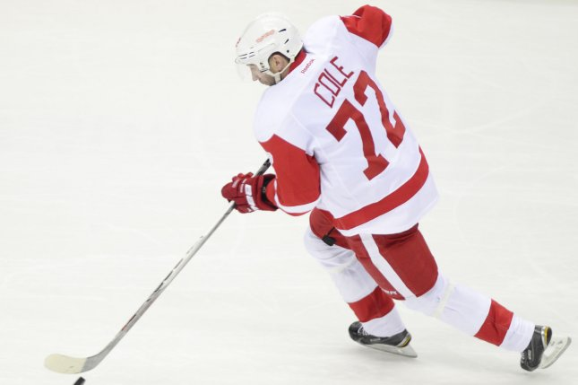 Detroit Red Wings Erik Cole breaks away and moves the puck towards the Pittsburgh Penguins goal in the second period of the Detroit Red Wings 5-1 win at Consol Energy Center in Pittsburgh on March, 15 2015. Photo by Archie Carpenter/UPI