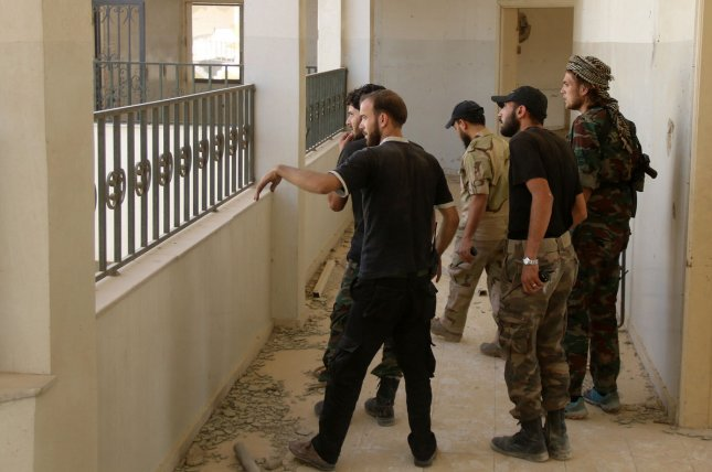 Syrian fighters from the Free Syrian Army take positions during fighting with the Syrian regime in Ghouta, in the Damascus countryside, Syria, on Oct. 12, 2015. Representatives from a series of major Syrian rebel groups merged in the capital of Saudi Arabia on Dec. 8, 2015 to agree on a negotiating platform for talks with the Syrian government in January. Photo by Ammar Al Bushy/ UPI