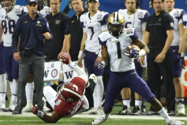 544ca5236af2 Alabama Crimson Tide linebacker Ryan Anderson (22) misses Washington  Huskies wide receiver John Ross (1) during the first half of the  Chick-fil-A Peach Bowl ...