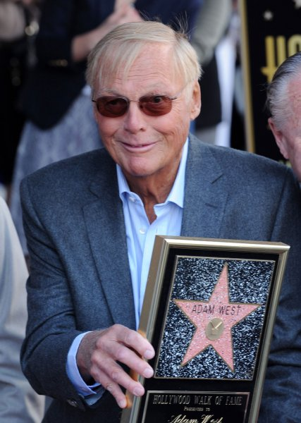 Adam West holds a replica plaque during an unveiling ceremony honoring him with the 2,468th star on the Hollywood Walk of Fame on April 5, 2012. West is set to appear in NBC's workplace comedy, Powerless. File Photo by Jim Ruymen/UPI