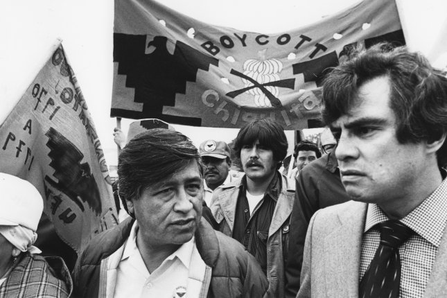 United Farm Workers (UFW) President Cesar Chavez (L) is accompanied by San Francisco supervisor Bob Gonzales (R) as they march in a picket line outside a supermarket in San Francisco on March 22, 1979. UPI File Photo