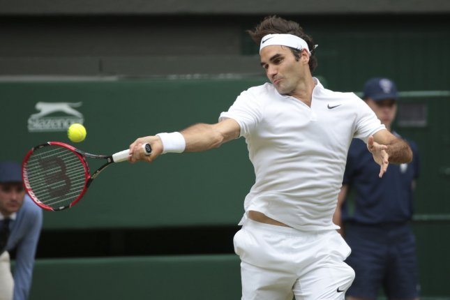 Swiss Roger Federer returns the ball in his Men's Semi-Final match against Canadian Milos Raonic at Wimbledon. File photo by Hugo Philpott/UPI