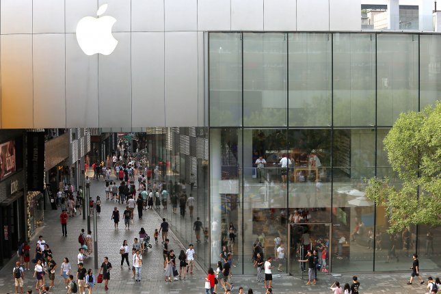 People walk past Apple's original flagship store in Beijing, China on July 17, 2017. Apple removed several foreign-developed virtual-private network applications from the China App Store, citing content that is illegal in China. Photo by Stephen Shaver/UPI