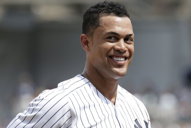 New York Yankees slugger Giancarlo Stanton smiles while he stands on third base in the 5th inning against the Kansas City Royals on Sunday at Yankee Stadium in New York City. Photo by John Angelillo/UPI