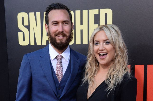 Kate Hudson (R), pictured with Danny Fujikawa, took to Instagram after welcoming a daughter with the musician. File Photo by Jim Ruymen/UPI