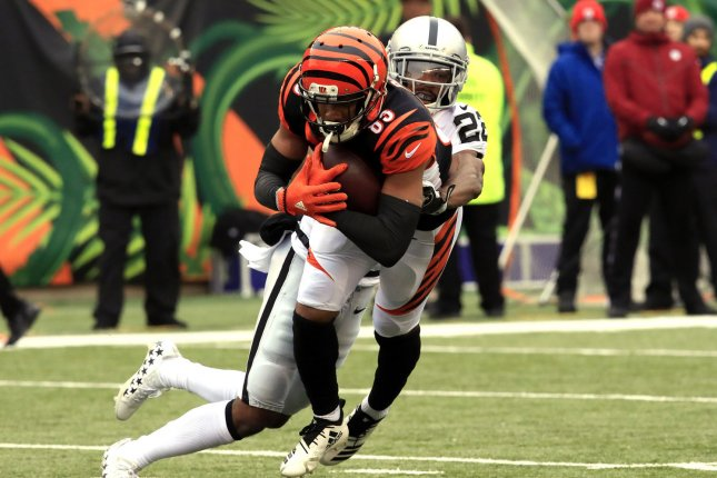Cincinnati Bengals wide receiver Tyler Boyd (83) is tackled by Oakland Raiders defensive back Rashaan Melvin (22) during the first half of play on Sunday at Paul Brown Stadium in Cincinnati, Ohio. Photo by John Sommers II/UPI