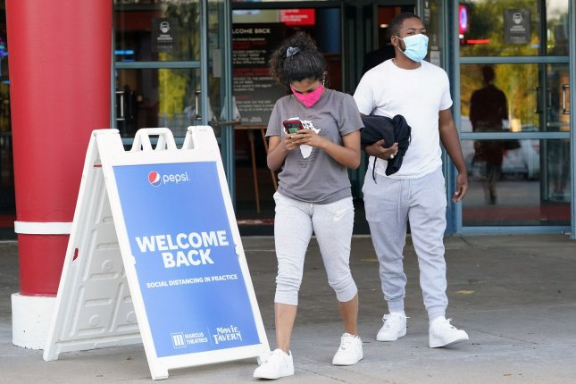 Patrons leave a movie theater in St. Charles, Mo., on August 21. After being closed for months due to the pandemic, movie theaters nationwide reopened on that day. Photo by Bill Greenblatt/UPI